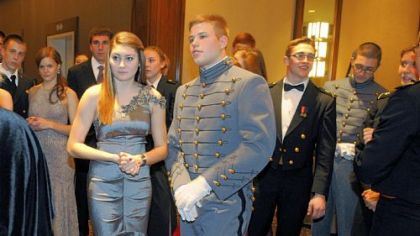Kenzie Stepanik and Army Cadet Andrew Irwin listen to instructions before the Grand March.