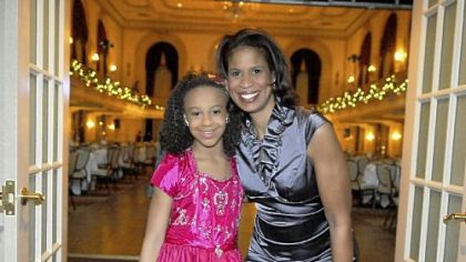 Nia Frazier , 9, with her mother Holly Hatcher-Frazier.