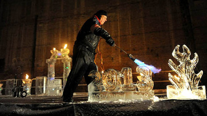 Rich Bubin of Ice Creations applies a blow torch to a 2013 ice sculpture Monday during Pittsburgh's First Night New Year's Eve festivities.