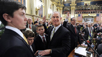 State House Majority Leader Mike Turzai, R-Bradford Woods, middle, is sworn into office Tuesday with a Bible held by his sons -- from left, Andrew, Matthew and Stephen -- on the floor of the House in Harrisburg.