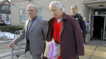 Former Penn State University assistant football coach Jerry Sandusky, center, leaves the Centre County Courthouse on Thursday, escorted by Centre County Sheriff Denny Nau, left, after attending a post-sentence motion hearing in Bellefonte.