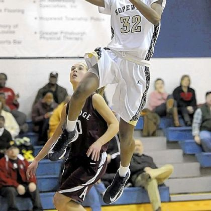 Hopewell's Shatori Walker-Kimbrough drives to the net against Ambridge Thursday night in a girls basketball game. Walker-Kimbrough went over 2,000 points for her career.