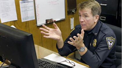 Steubenville police Chief William McCafferty sits behind a computer as he discusses an email he had opened earlier that disabled his PC.