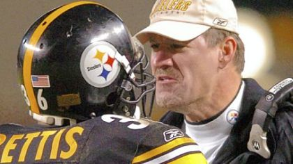 Steelers coach Bill Cowher greets Jerome Bettis after he scored a touchdown against the Jets