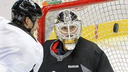 Tomas Vokoun, expected to back up Marc-Andre Fleury in goal this season, makes a save at an informal workout Thursday at Consol Energy Center. Because of the shortened season after the 112-day lockout, goalies likely will be under pressure more than usual.