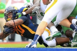WVU fullback Alston following an unusual path