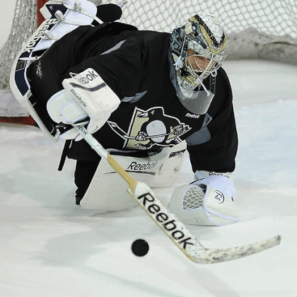 Penguins goalie Marc-Andre Fleury makes a save during afternoon workouts at Southpointe.