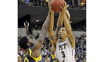 Pitt's Cameron Wright drives to the net against Marquette's Jamil Wilson in the first half this afternoon at the Petersen Events Center.
