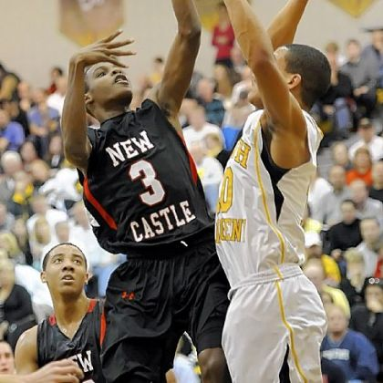 New Castle's Drew Allen gets a shot up against North Allegheny's Elijah Zeise Friday night.