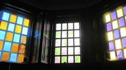 Stained glass in the upper windows of the den.