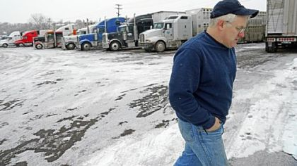 Trucking companies can't find enough drivers to fill demand because of the pay and long hours on the road. Roy Olds, shown at a truck stop in Minneapolis, is one of those who puts in many miles driving across the country making deliveries.