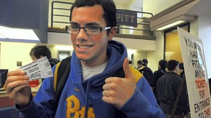 Frank Paciaroni, a freshman at Pitt, shows off the tickets he scored to the Stephen Colbert event Friday.