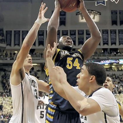 Marquette's Davante Gardner drives to the hoop against Pitt's Steven Adams and James Robinson in the Golden Eagles' Big East win.