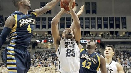 Marquette's Todd Mayo blocks a shot by Pitt's Trey Zeigler in the first half Saturday at Petersen Events Center.