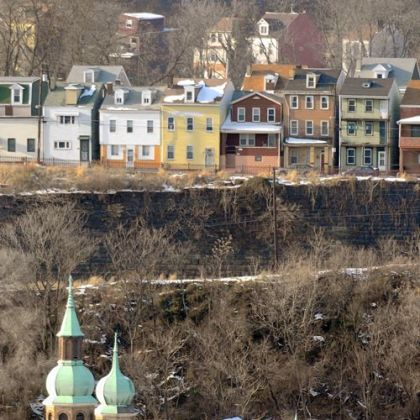 The homes of Pittsburgh's Troy Hill overlook St. Nicholas Church Tuesday as work crews prepare the building for demolition.