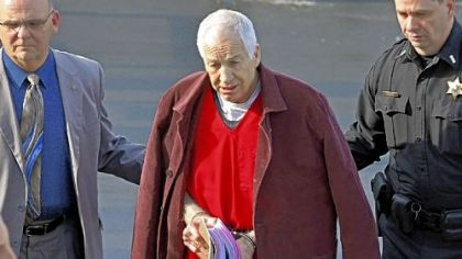 Former Penn State University assistant football coach Jerry Sandusky, center, leaves the Centre County Courthouse after attending a post-sentence motion hearing Thursday in Bellefonte, Pa.