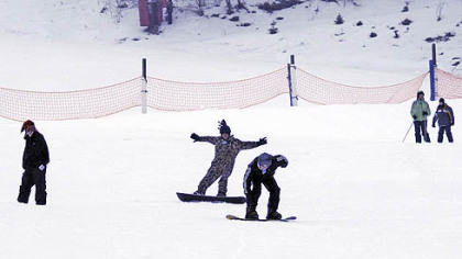 Ice storm and rain fails to stop boarders at Hidden Valley Resort in 2008.