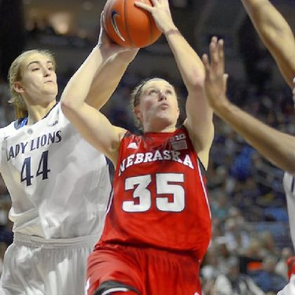 Nebraska's Jordan Hooper shoots as Penn State's Tori Waldner defends from behind Sunday in the Nittany Lions' 80-58 win.