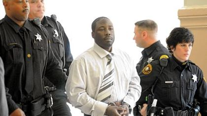 Ronald Robinson is escorted from Judge Kevin Sasinoski's courtroom for a lunch recess on the first day of his murder trial Thursday. He is accused of killing Penn Hills police officer Michael Crawshaw in December 2009.