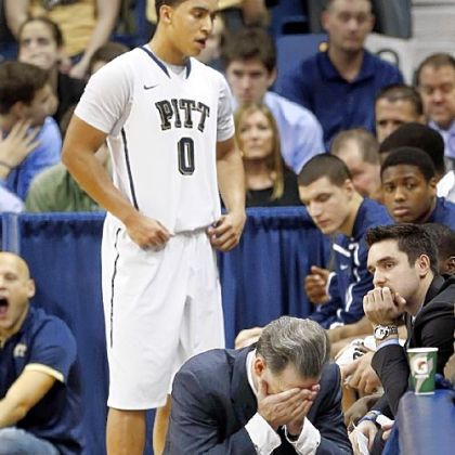 Pitt coach Jamie Dixon squats along the bench as time runs down in the overtime period Saturday against Marquette. The Panthers lost, 74-67, to drop to 1-3 in the Big East.