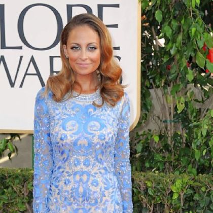 Nicole Richie attended the Golden Globes wearing a saturated pale blue gown by Naeem Khan.