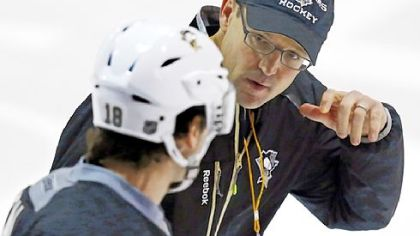 Penguins coach Dan Bylsma, right, talks with James Neal Sunday at practice.