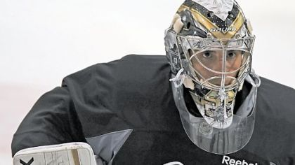 Penguins goalie Marc-Andre Fleury eyes up a slap shot at drills Sunday, the first day of Penguins camp.