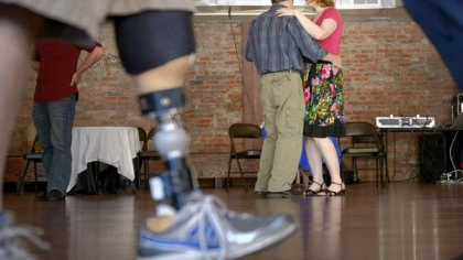 Krista and Cleve Cooke of Morningside dance during a &quot;Salsa for Soldiers&quot; fundraiser at Pittsburgh Dance Studio in Bloomfield.