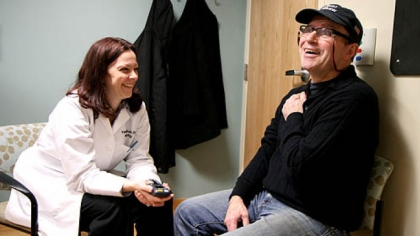 Toni Pais talks to UPMC neurologist Valerie Suski during a February checkup.