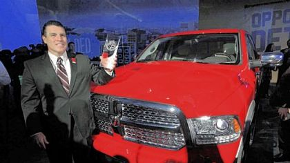 Fred Diaz, president and chief executive officer of Ram Truck Brand, with the Ram 1500 after the vehicle was awarded the North American Truck of the Year at the North American International Auto 