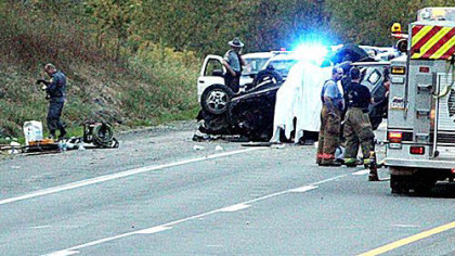 Emergency workers respond to the scene of a fatal wreck on Oct. 3, 2012, near the Ruff Creek exit of Interstate 79 in Greene County.