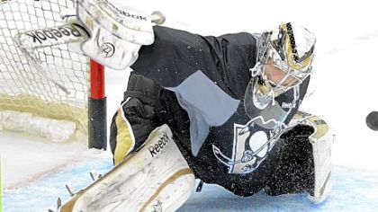 Marc-Andre Fleury makes a save in practice Tuesday at Consol Energy Center. After tonight's scrimmage, the team has just one more practice before opening the season Saturday.
