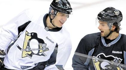 Evgeni Malkin is getting reacquainted with his teammates, such as Kris Letang, and the North American style of hockey.
