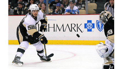 Kris Letang, member of the Penguins white team, scores in the first period of an exhibition scrimmage.