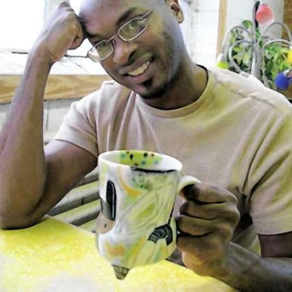 Chicago ceramist Kevin Snipes, with one of his mugs, will teach and speak here on Monday.