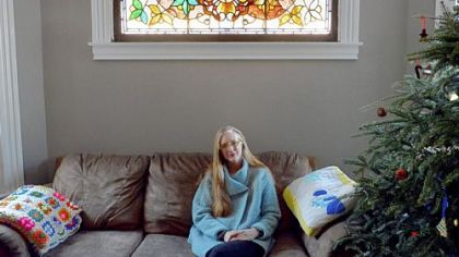 Kasey Connors of Wilkinsburg with a stained-glass window that was uncovered in a wall in one of her houses. She will speak about buying and restoring properties at 10 a.m. today at the Landmarks Housing Resource Center, Wilkinsburg.