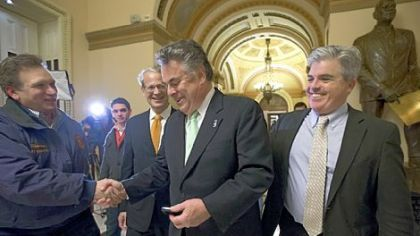 From left, Nassau County Executive Edward P. Mangano, Rep. Steve Israel, D-N.Y., Rep. Peter King, R-N.Y., and Suffolk County Executive Steve Bellone celebrate at the Capitol Building Tuesday after the House of Representatives passed a $50.7 billion emergency aid bill for states hit by Superstorm Sandy.