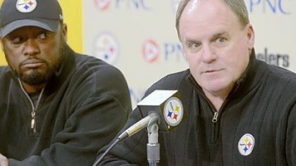 General manager Kevin Colbert, right, and Coach Mike Tomlin speak to the media before the NFL draft last spring.
