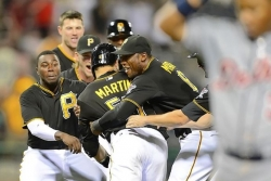 Martin's single in 11th lifts Pirates over Tigers, 1-0