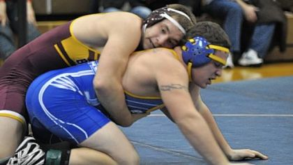 Char-Houston&#039;s Garrett Vulcano controls West Greene&#039;s Cody Jacobs in a 195-pound weight class match at the Tri-County Tournament Saturday.