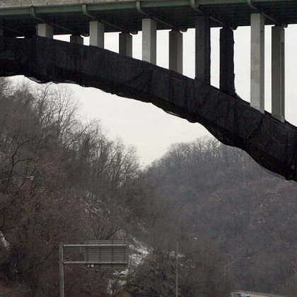 The inbound lanes of the Parkway East were closed as PennDOT inspection crew are lowered into place to inspect the underside of the Greenfield avenue Bridge.