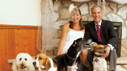 Janine and Robert Fragasso and their five dogs. The Fragassos are setting aside $5,000 for the long-term care of each of their pets.