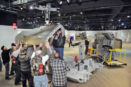 "Vietnam War veterans help assemble a UH-1H ""Huey"" helicopter at the Heinz History Center to be displayed in the upcoming exhibit, ""1968: The Year That Rocked America."" The exhibit's helicopter, which flew with the Army in Vietnam from 1967 through 1970, is the largest artifact ever at the museum."