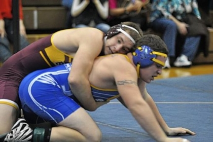 Char-Houston's Garrett Vulcano controls West Greene's Cody Jacobs in a 195-pound weight class match at the Tri-County Tournament Saturday.