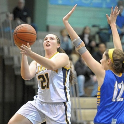 Mt. Lebanon's Jordan Holmes, center, is contested by Canon-McMillan's Brittany Hutchinson, left, and Danielle Parker Thursday at Mt. Lebanon. Mt. Lebanon won, 57-23.