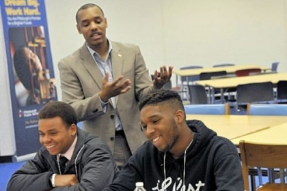 Charles Small, center, of the University of Pittsburgh, speaks to African-American male high school students Thursday. Listening are Chekaesha Neal, 17, and Mecca Wright, 16.