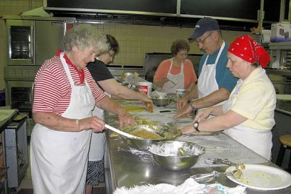 In the kitchen at Resurrection Byzantine Catholic Church, volunteers Dolores Bailey, Connie Beatty, Beverly Kachurik, Jim Silvestri and Rozena Kokal prepare nut horns.