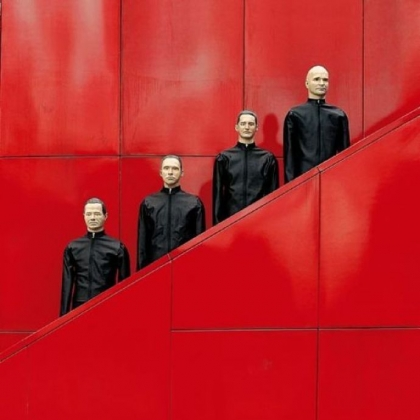 "Peter Boettcher's ""Kraftwerk Roboter 4"" is among photographs of the band in an exhibition at the NRW Forum in the band members' home city of Dusseldorf, Germany, where they are playing a series of eight concerts."