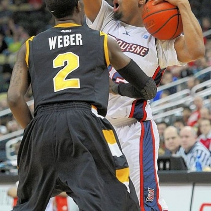 Duquesne's Sean Johnson looks for an open man while being guarded by Virginia Commonwealth's Briante Weber in an Atlantic 10 game Saturday night at Consol Energy Center.
