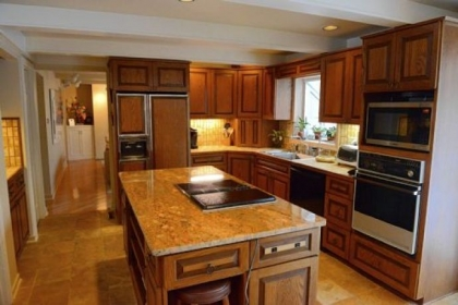 The granite counter top on the island in the kitchen was recently installed.
